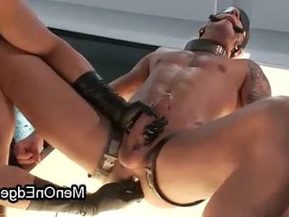 Shackled gay dick slapped while ssunburnding and ball sackack wired on neon table